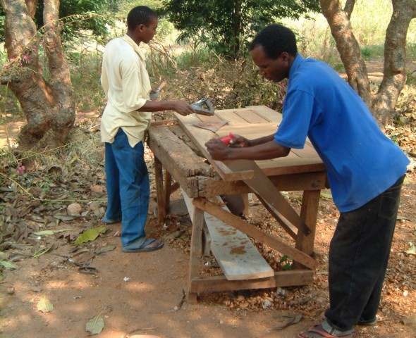 Gilbert Samile and Musa Making Door